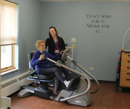 Resident using equipment with therapist